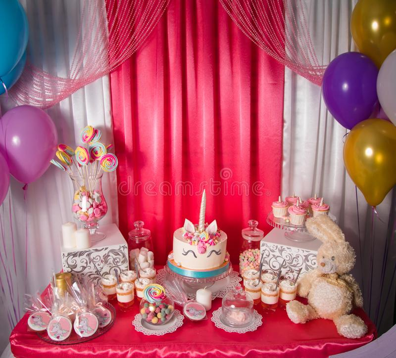 Sweet Table And Big Unicorn Cake For Baby Girl First Birthday Candy Bar With A Lot Of Different Candies And Sweet Cakes Stock Photo Image Of Unicorn Plate 129869462
