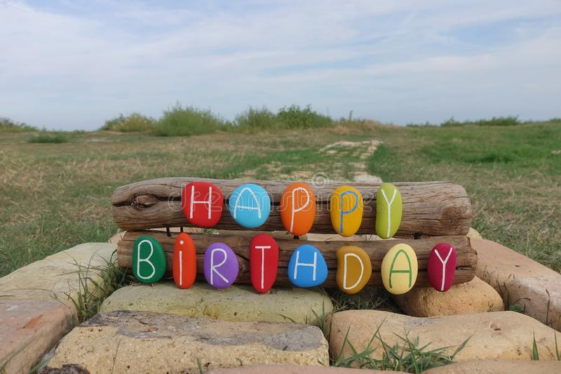 Happy Birthday Composition With Colored Stones On Woods And Bricks With Nature Background Stock Photo Image Of Text Outdoors 128484690