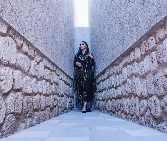 Woman In Black And Gold Traditional Dress Between Gray Concrete Walls Free Public Domain Cc Image
