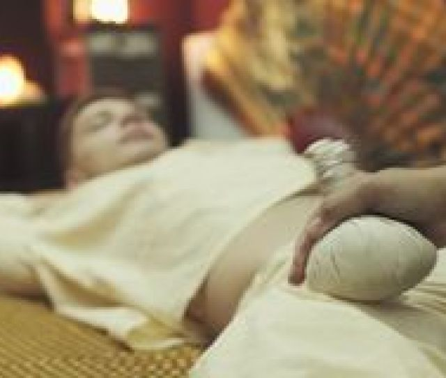 Thai Foot Massage With Herbal Pouches Stock Video