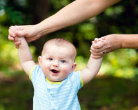 Happy baby boy learning to walk on grass Stock Photography
