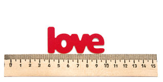 https://i2.wp.com/thumbs.dreamstime.com/t/measuring-word-love-white-38500384.jpg