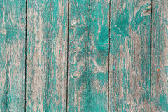 Blank Weathered Sign With Wooden Cross Hanging By Rope On Antique Teal Blue Wood Door Stock
