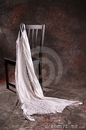 Black chair with white dress