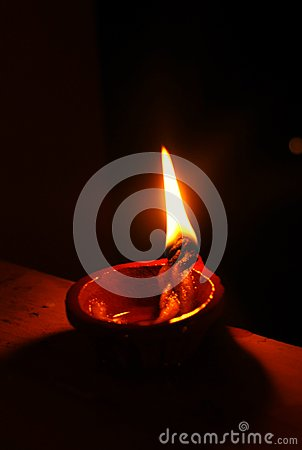 Brightly lit earthen lamp during Diwali