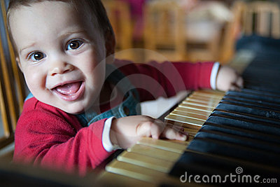 Child Playing The Piano Royalty Free Stock Photo - Image: 19892885