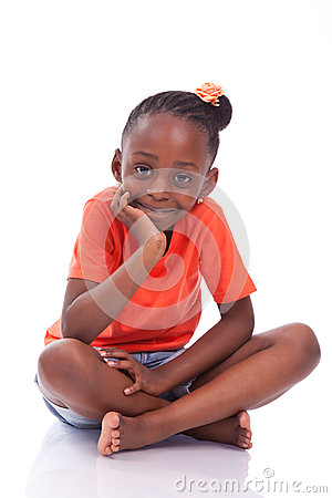 Cute Little African American Girl Sitting On The Floor