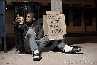 Homeless Man Holding A Sign Royalty Free Stock Photos