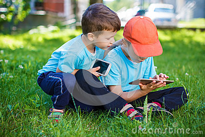 Little boys playing on wireless tools