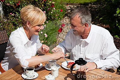 Mature couple having coffee on porch Stock Photos - Image: 12745943