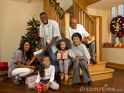 Mixed Race Family Around Christmas Tree Stock Images