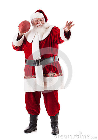 Santa Claus Holds Football And Is Ready To Throw Stock