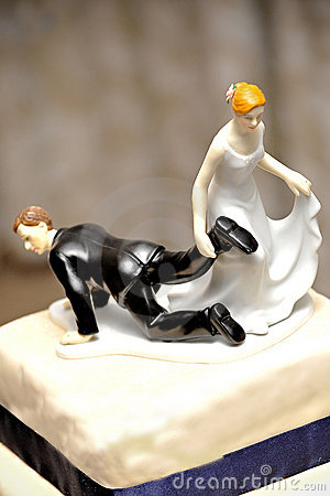 Wedding Figurine With Bride Dragging The Groom Royalty