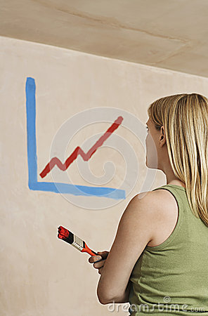Woman Holding Paintbrush With Painted Diagram On Wall