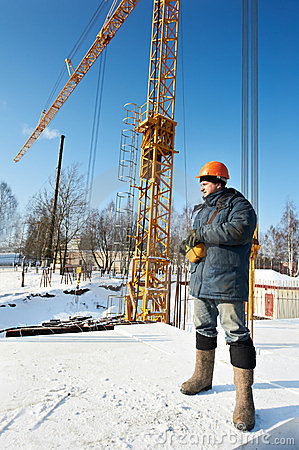 Worker with tower crane remote control equipment