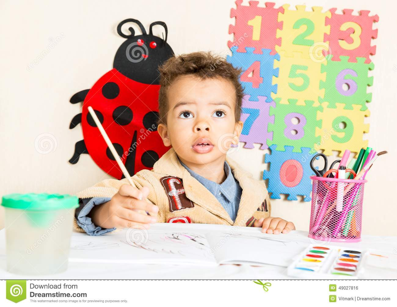 African American Black Boy Drawing With Colorful Pencils
