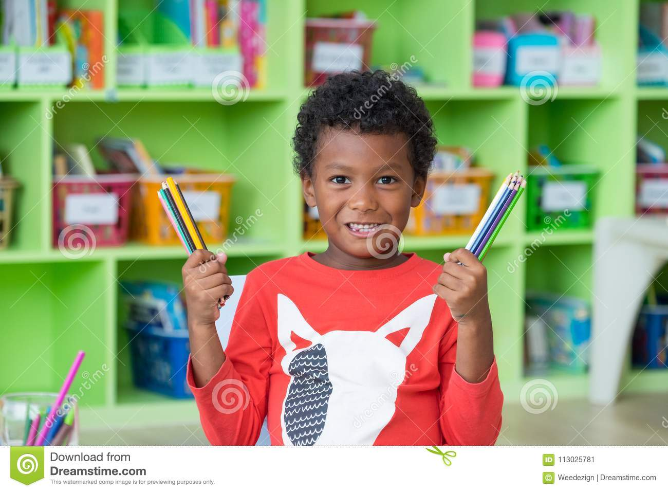 African American Ethnicity Kid Holding Group Of Color