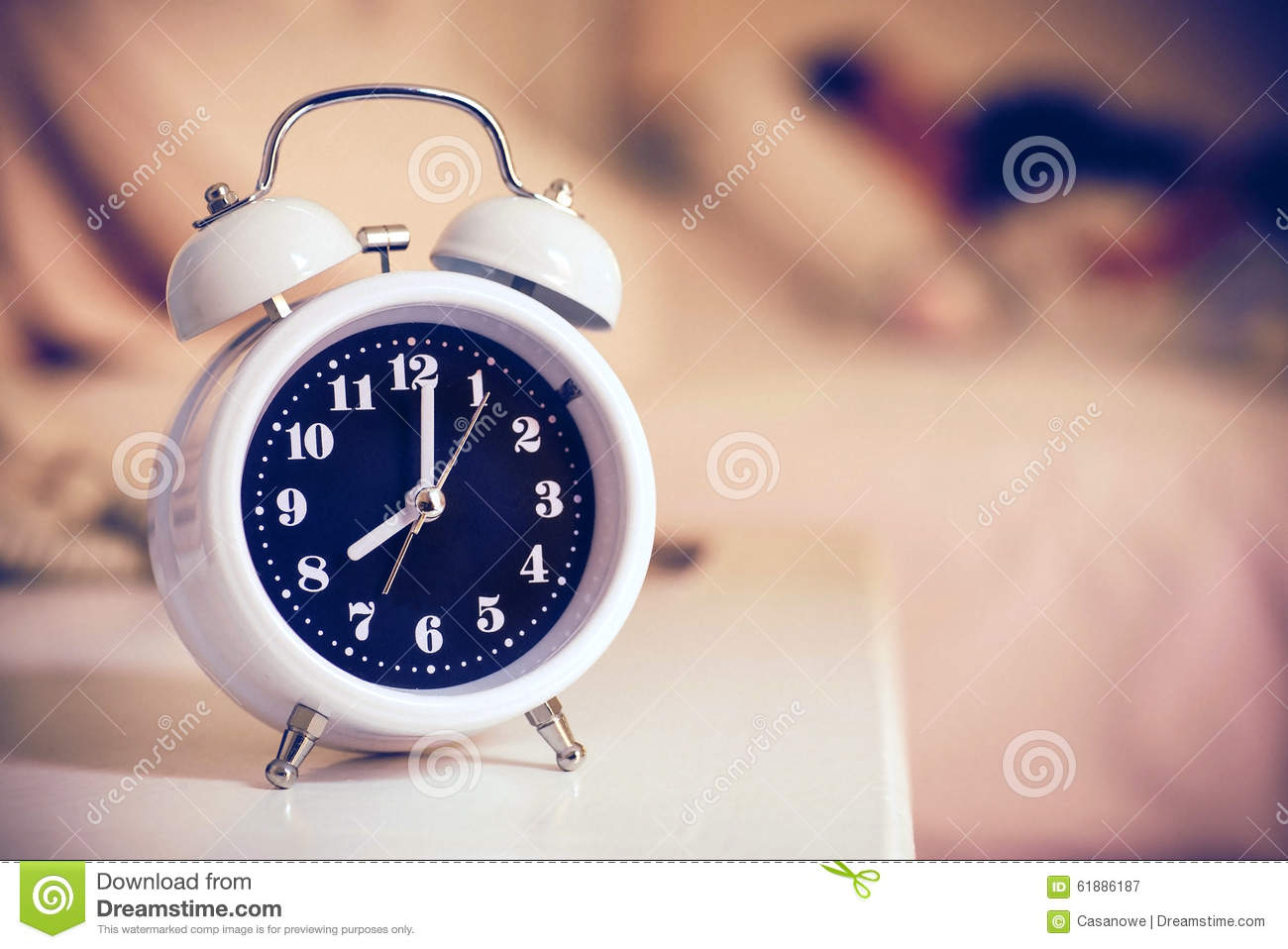Alarm Clock On The Bed In Bedroom, Retro Style Stock Image