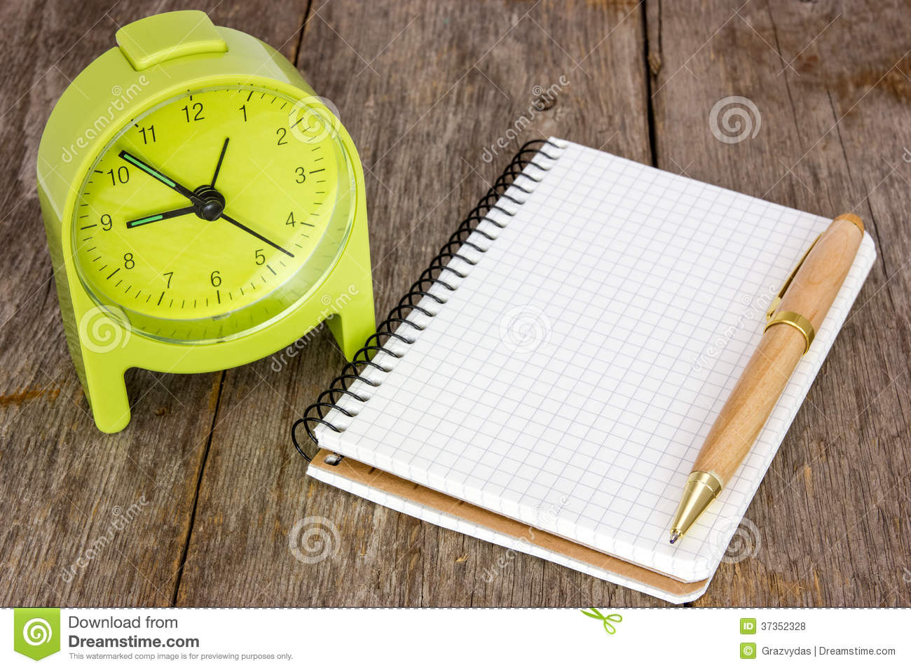 Alarm Clock And Blank Notebook Stock Photo