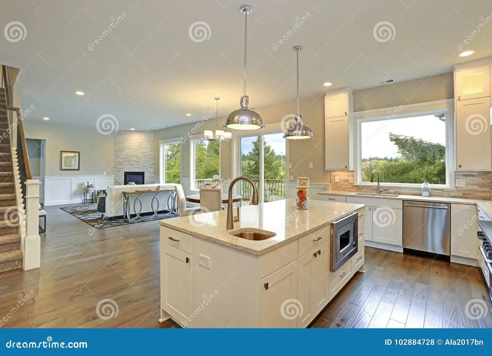 https www dreamstime com amazing white kitchen design shaker cabinets paired gray marble counters large peninsula sink hardwood floors luxury image102884728