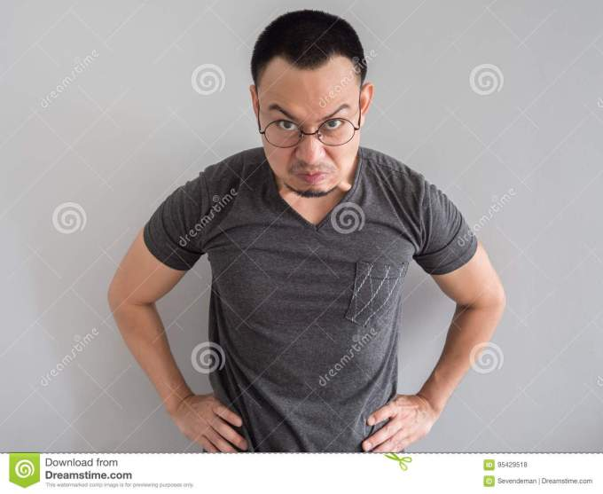 angry and crazy face of man in black t-shirt. stock photo