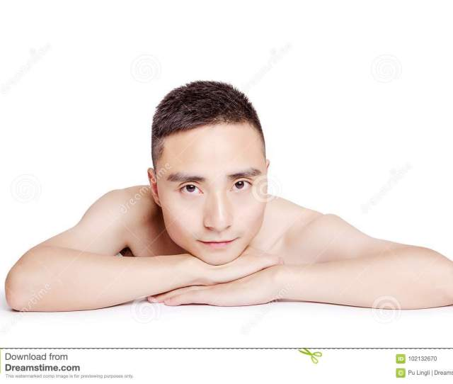 Asian Man Lie In Front Of The White Background