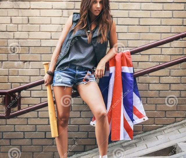 Bad Girl Holding A Baseball Bat And British Flag At Street