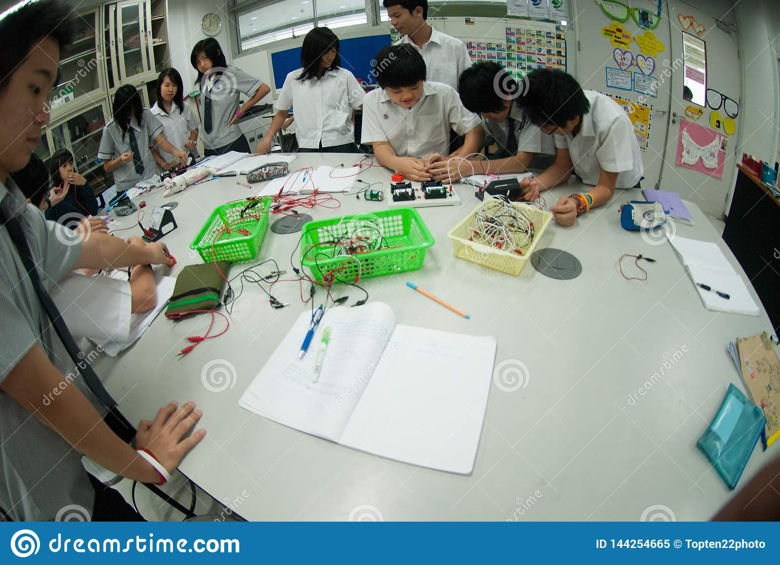 Group Of Asian Elementary Students Are Learning About