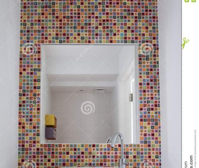 Bathroom Wash Basin With Colorful Glmosaic Tiles And Mirror Inset Into The Tiles