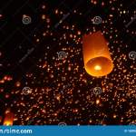 Beautiful Nighttime Shot Of Flying Paper Lanterns During The Yi Peng Festival In Thailand Stock Image Image Of Celebration Event 160955463