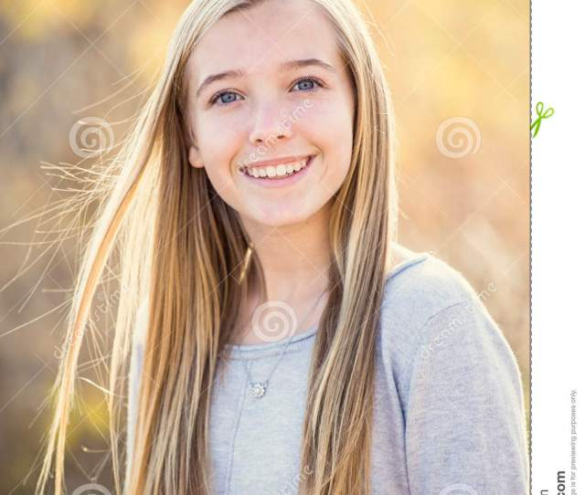 Beautiful Portrait Of Smiling Teen Girl Outdoors Taking A Cute Picture On A Warm Fall Day Girl Looking At The Camera With A Huge Smile On Her Face
