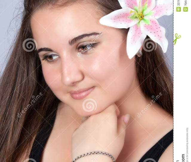 Beautiful Girl With A Flower In Hair