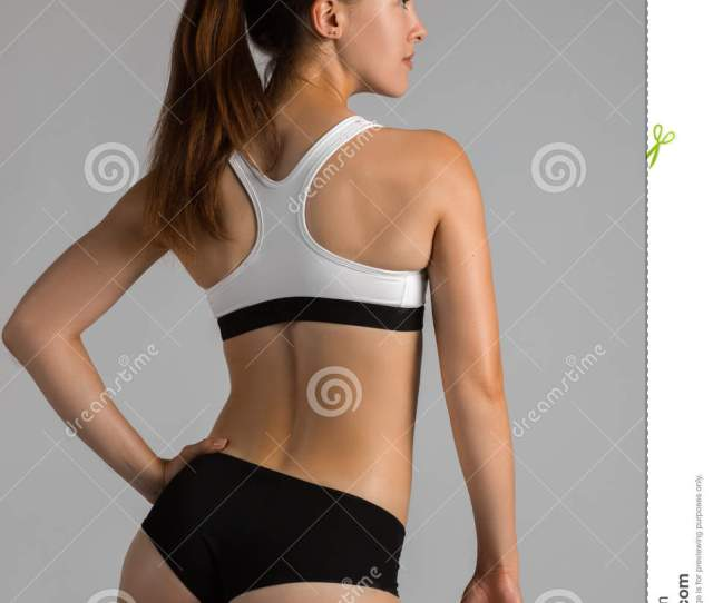 Beautiful Super Fit Young Woman Showing Off Her Perfect Muscular Body Fitness Model Training With Dumbbell Weight Perfect Slim Body With Sturdy Back