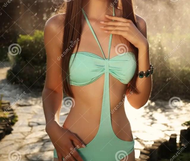 Beautiful Tanned Girl With Dark Hair In Elegant Swimsuit