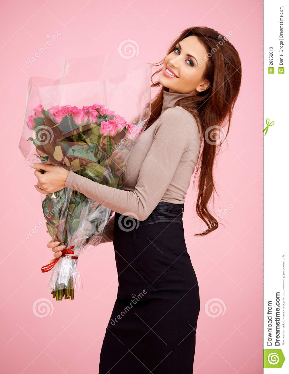 Beautiful Woman With Large Bouquet Of Roses Stock Image