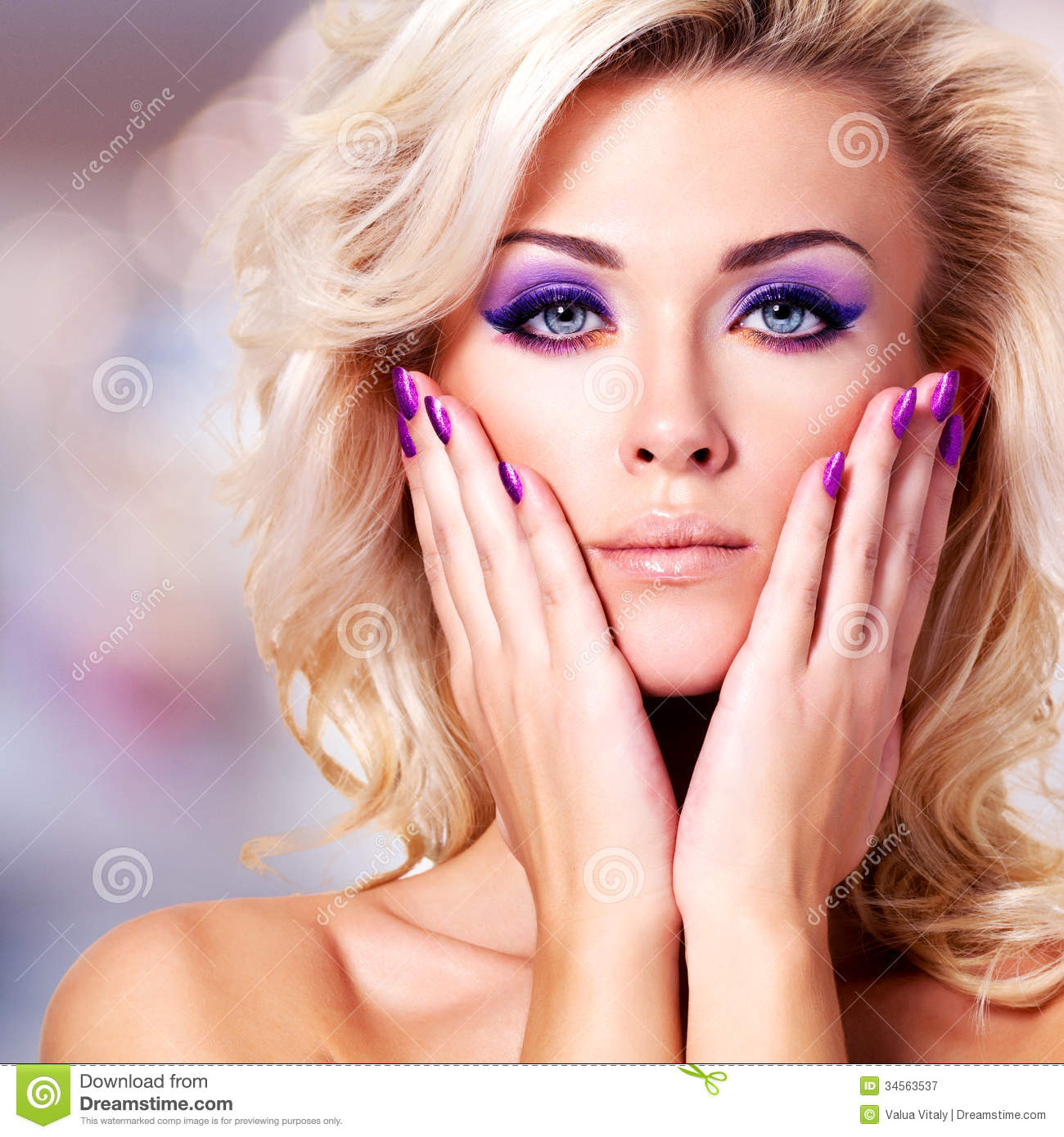 beautiful woman with purple nails and glamour makeup royalty free