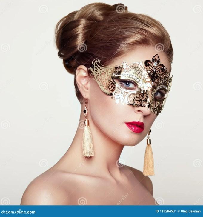 beautiful woman in venetian masquerade mask stock image