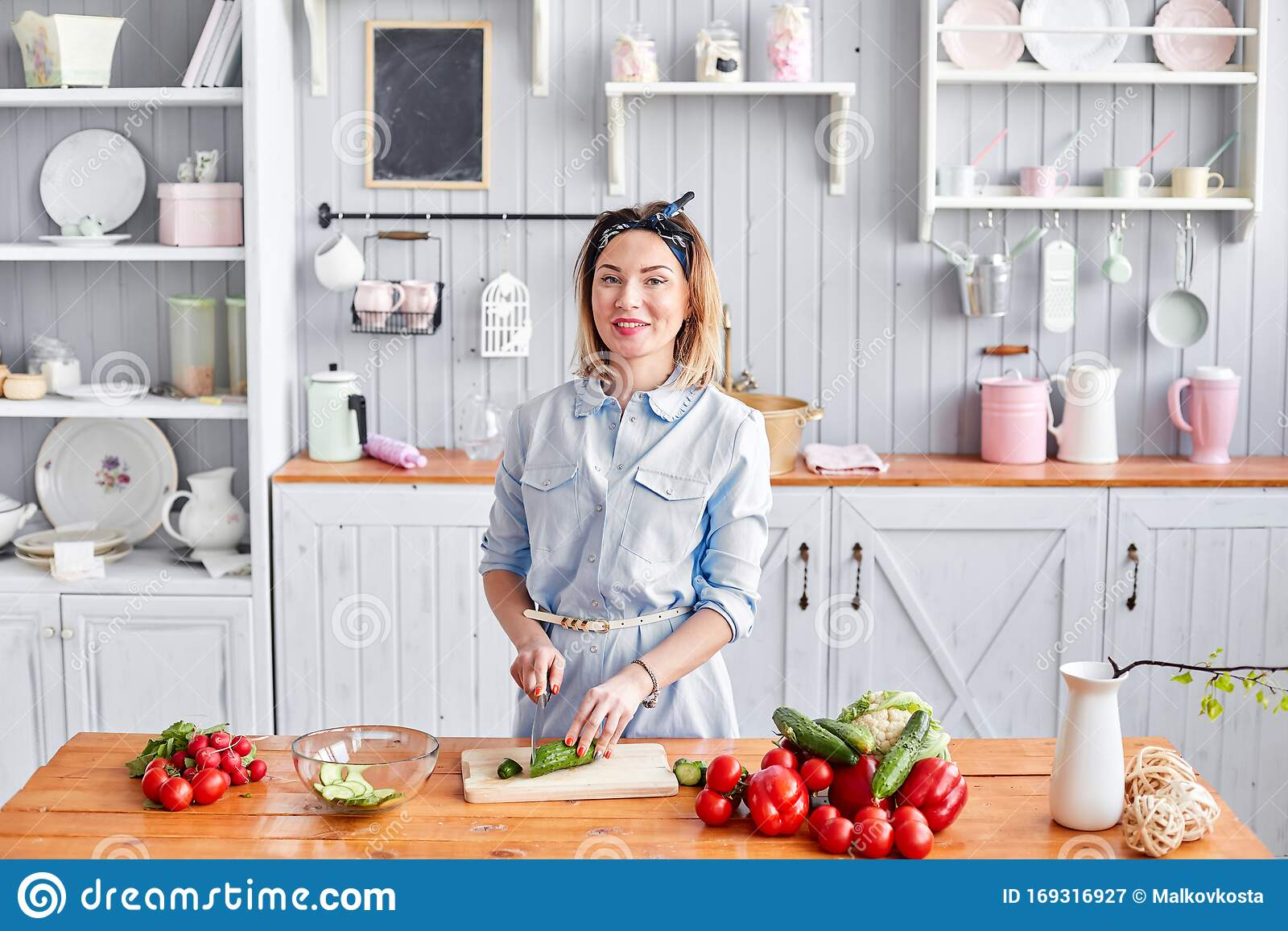 Beautiful Young Woman Is Preparing Vegetable Salad In The
