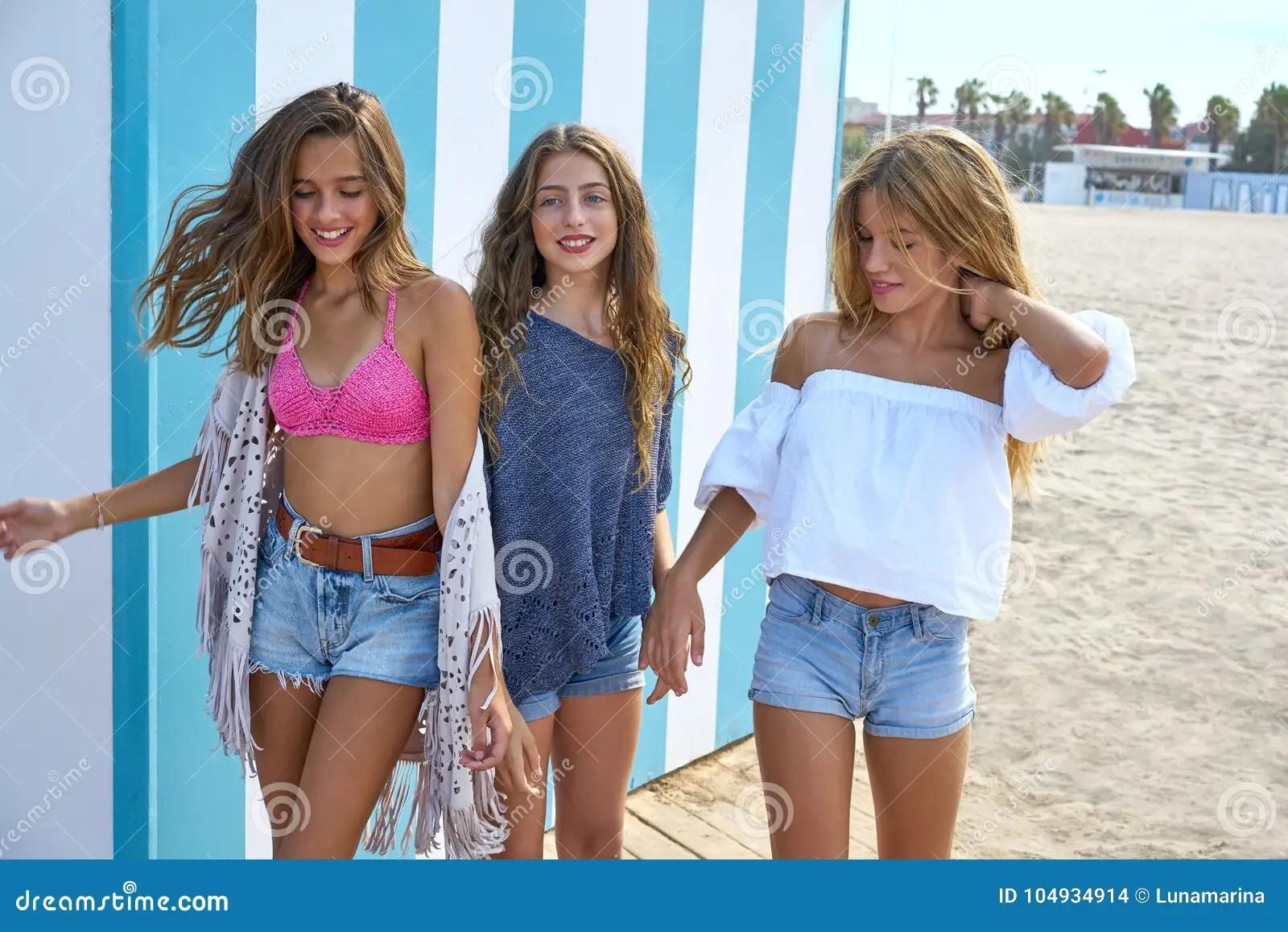 Best Friends Teen Girls Group Happy In A Summer Blue Stripes Background