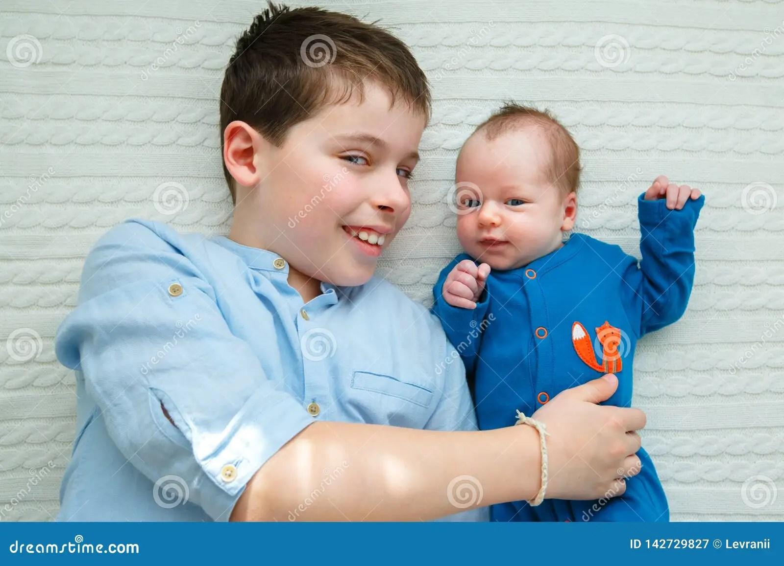 Big Brother Hugging His Newborn Baby Girl Toddler Kid