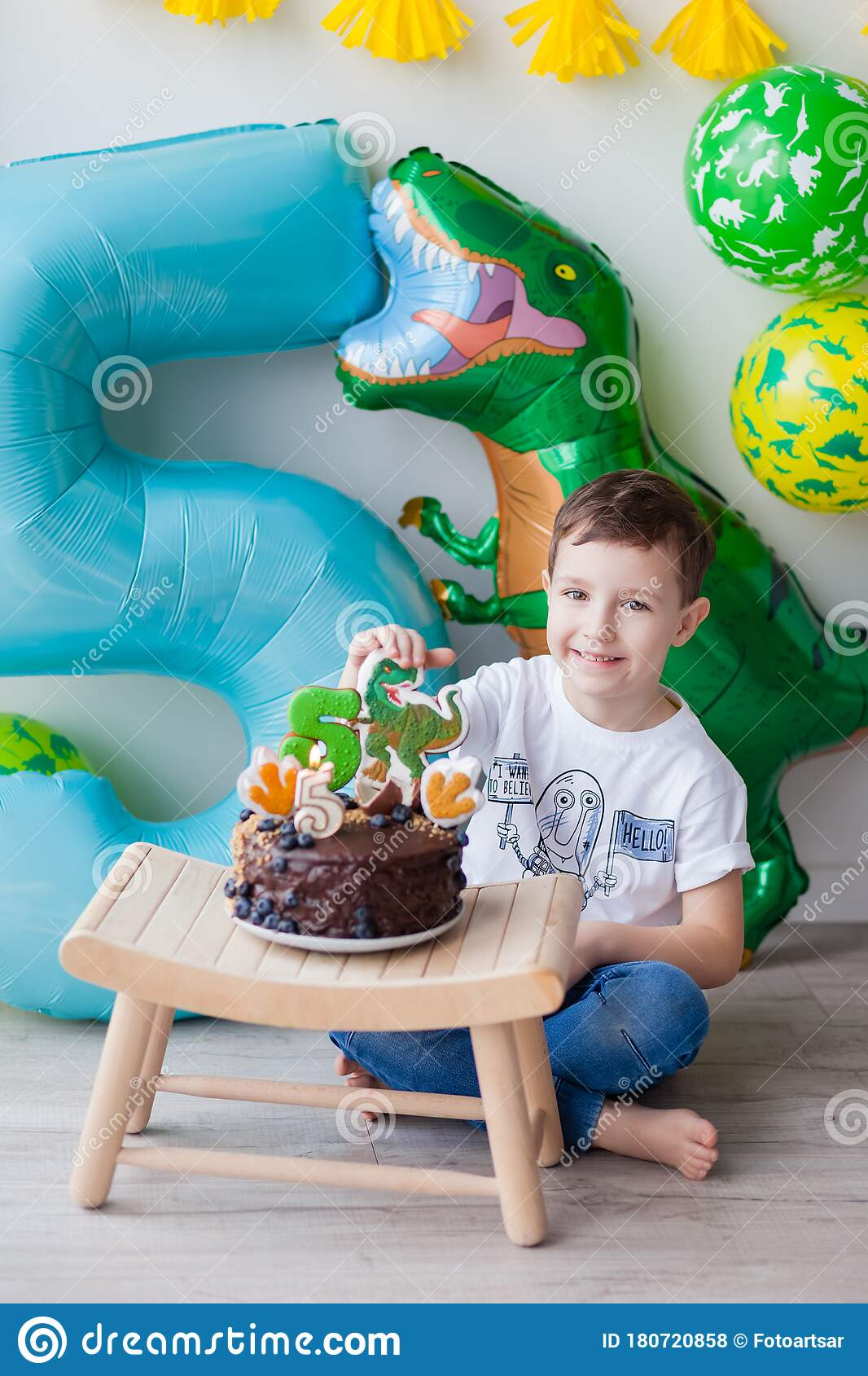 Birthday Boy A Boy Who Is 5 Years Old Sits At A Small Table With A Chocolate Birthday Cake Stock Photo Image Of Meal Flour 180720858