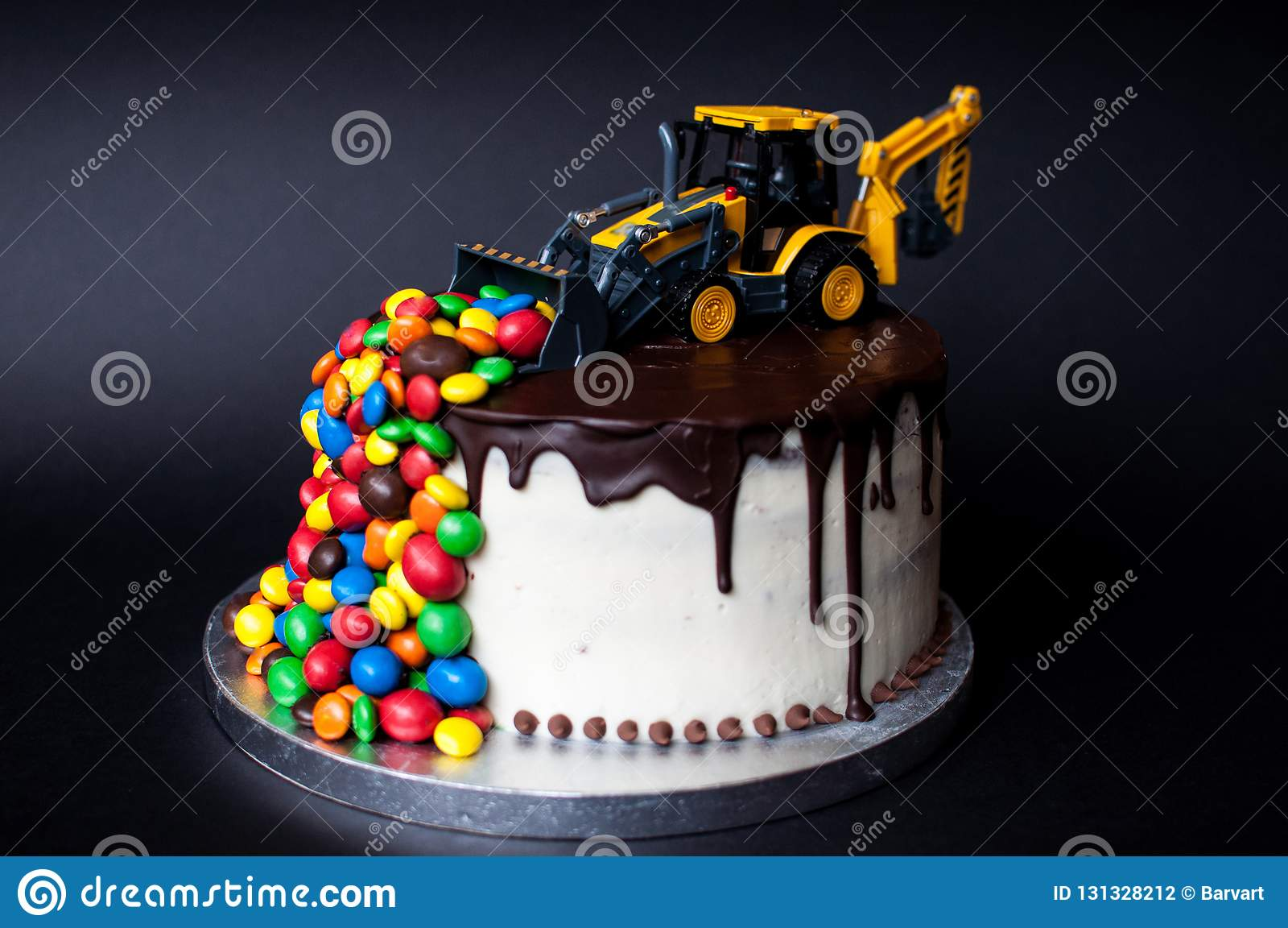 Birthday Chocolate Cake With Tractor And Candy On Top