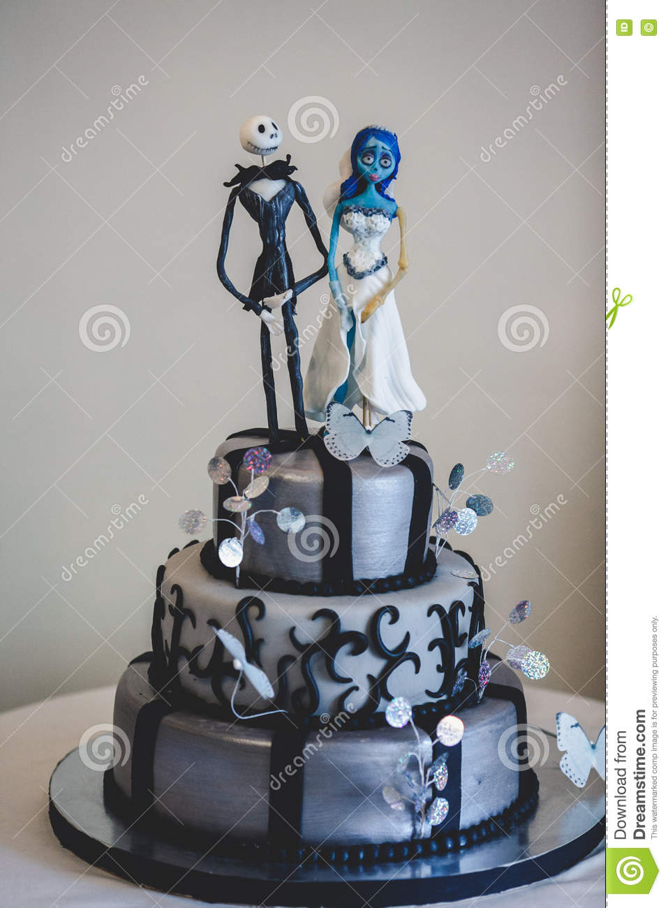 Black Gothic Wedding Cake Decorated With Figures Of
