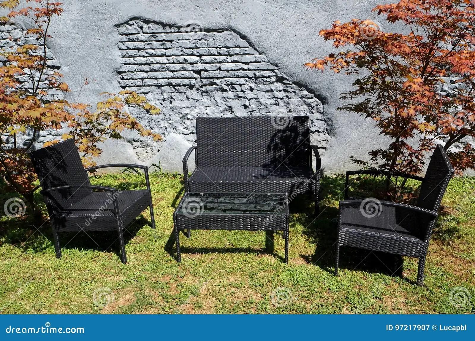 https www dreamstime com stock photo black wicker patio furniture garden front grey brick wall image97217907