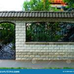 Black Wrought Iron Fence And Front Yard Entrance Door Stock Photo Image Of Concrete Entrance 151881048