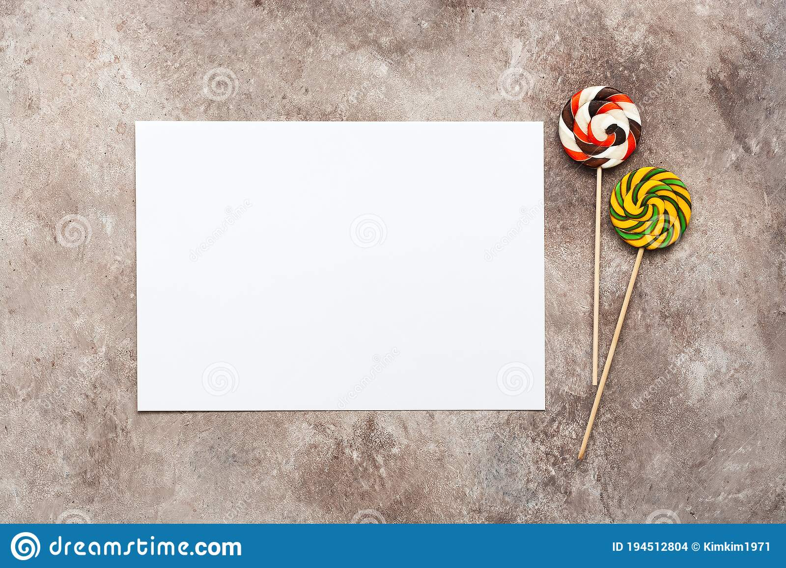 blank card mockup and colored lollipops on a beige grunge background template for greeting card or birthday invitation top view stock photo image of grunge card 194512804