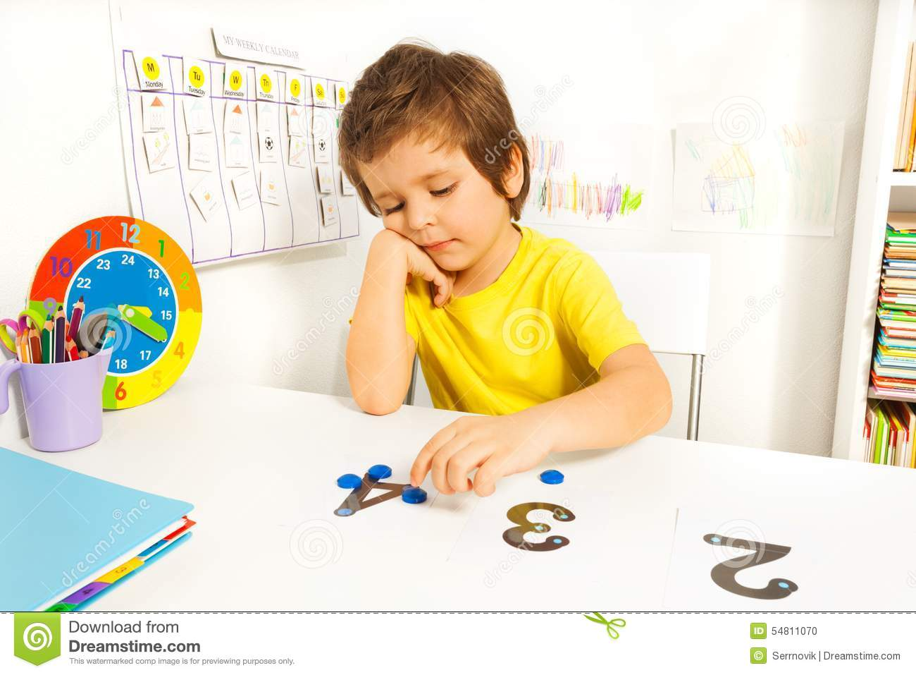 Boy Puts Learn To Count With Numbers And Values Stock Photo