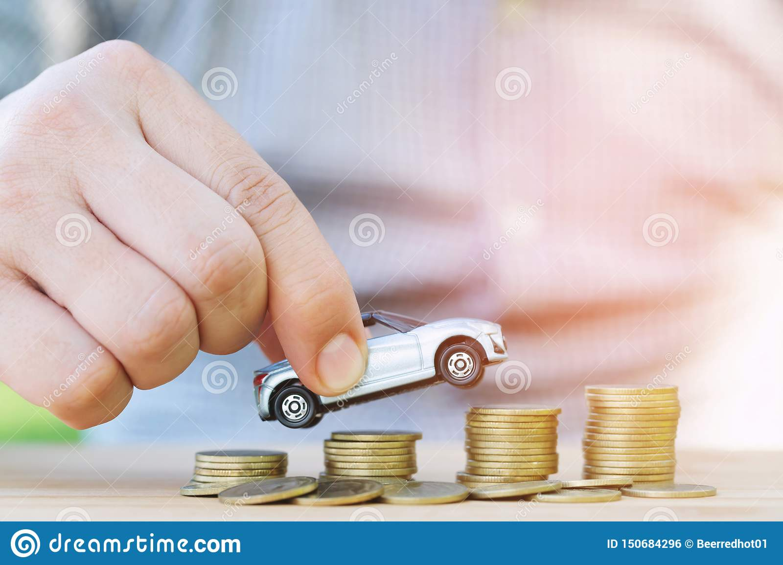 Business Man And Close Up Hand Holding Model Of Toy Car On