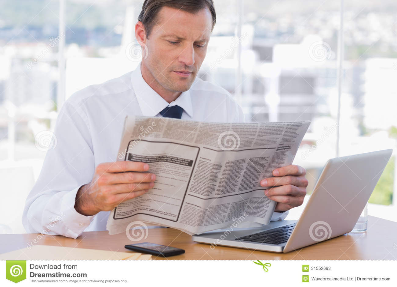 Businessman Reading A Newspaper Stock Photos