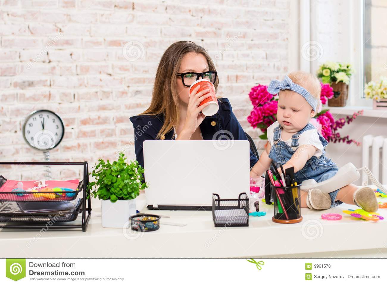 Businesswoman Mother Woman With A Daughter Working At The